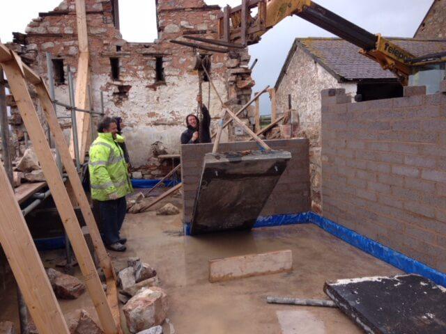 Re-erecting the slate wall in The Longbarn